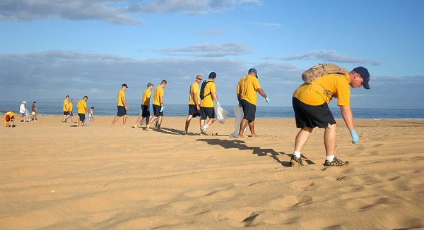 sailors-and-pacific-missile-range-facility-personnel-pick-up-trash-during-a-beach-clean-up_l