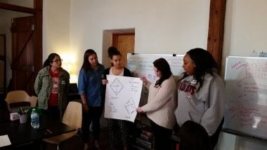 Leading for Good Interns present to community members and restaurant owners.