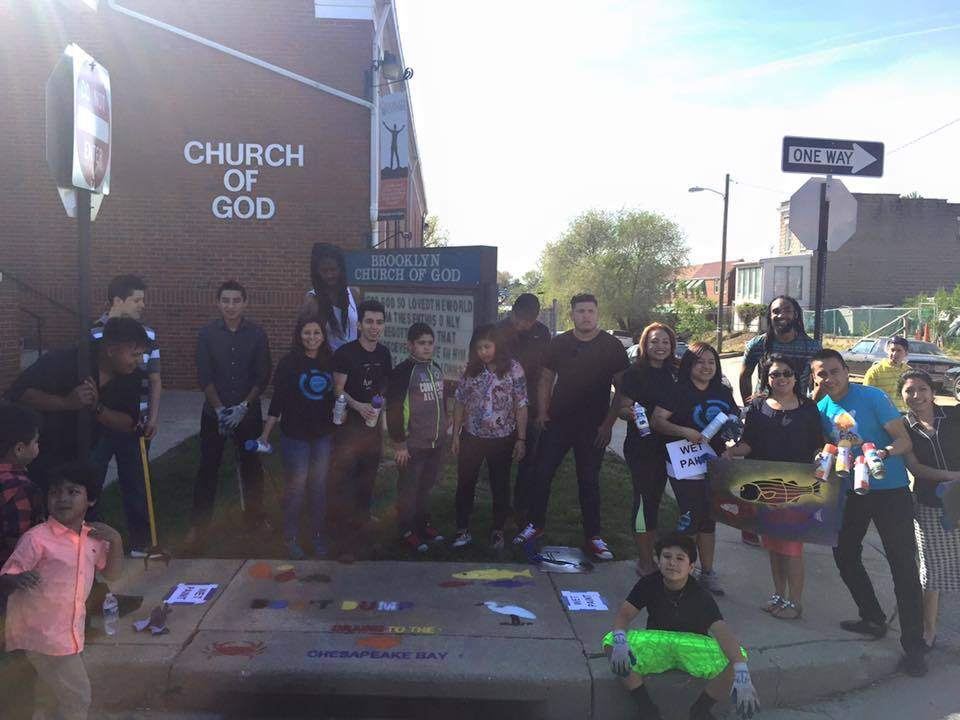 TAYR congregation members painting storm drains outside their church-min